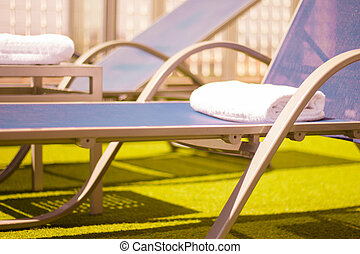Pool loungers without people - Part of pool in a hotel with ...