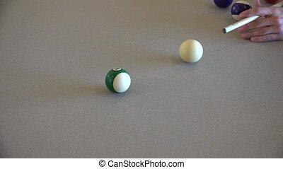 pool player at billiard table