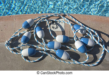 Pool Side - details of blue safety line on side of pool with...