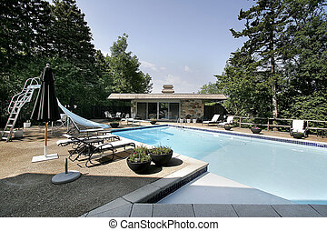 Pool and deck with slide and house