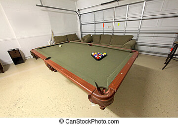 Pool Table - A pool table with balls in a home