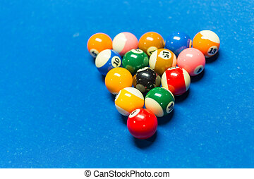 Pool table - Balls racked on on a pool table with blue felt
