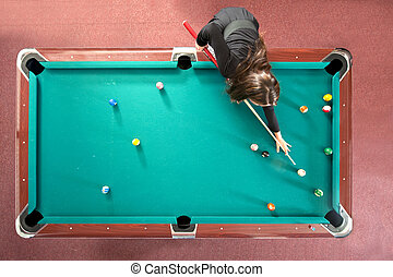 Pool table from above - Pool table with a girl playing, seen...