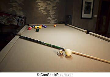 pool table with pool balls and stick