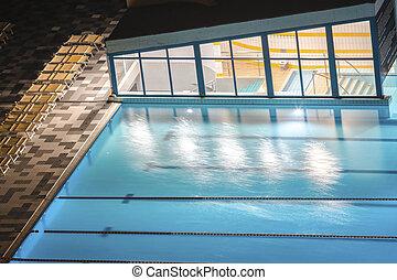 Pool under light at night