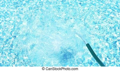 Pool Water Background Loop. 4k, close-up. water flows into...