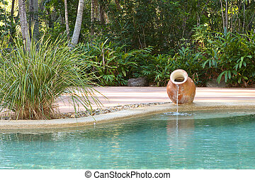 Pool with Water Feature - A nice backyard pool with a water...