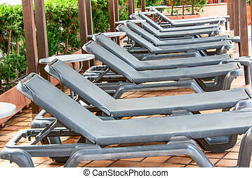 Poolside benches in line