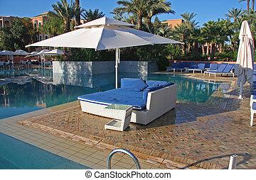 poolside, deckchairs