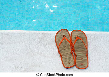 poolside - Sandals at the pool on a very sunny day