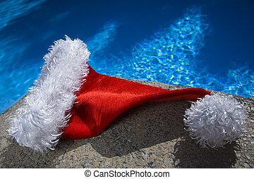 Poolside Santa Hat - Nice santa hat by a blue swimming pool