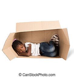 Poor child - Poor little girl sleeps in a cardboard
