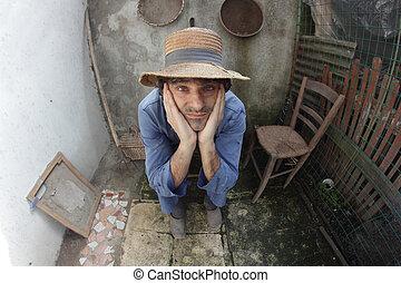 poor farmer at home - poor caucasian farmer siting in a...