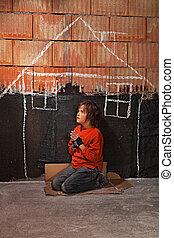 Poor homeless beggar boy praying for a shelter concept - ...