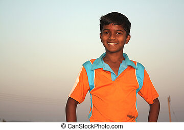 Poor Indian Boy - A portrait of a poor Indian village boy in...
