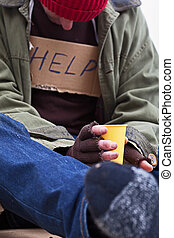 Poor man begging for a help with tea cup