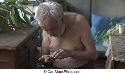 Poor man counting cents in a hand - Homeless person holding...