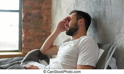 Poor millennial guy struggling with severe headache - Cant...