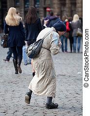 Poor old woman begging in Brussels