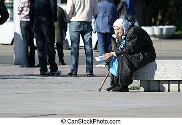 Elderly woman begging a handout.