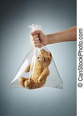 Poor Teddy - Old generic teddybear in a clear plastic bag.