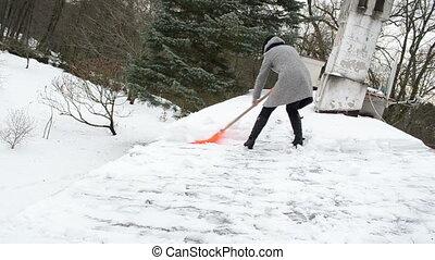 poor woman clean snow