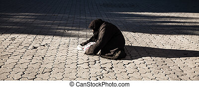 begging for money - Poor woman on the street begging for...