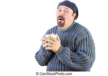 Poorly man in blue sweater with hot drink