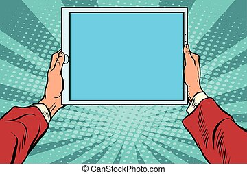 Pop art electronic tablet in the hands