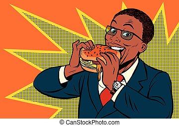 Pop art man eating a Burger, retro comic book vector...