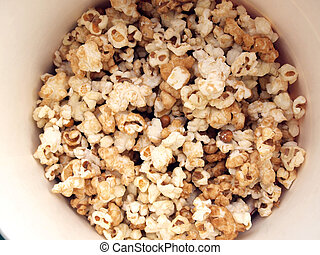 pop corn in caramel syrup in the paper box