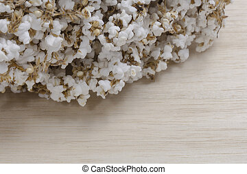 pop rice on wood background