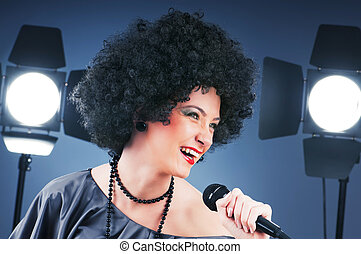 Pop star singing the song at concert