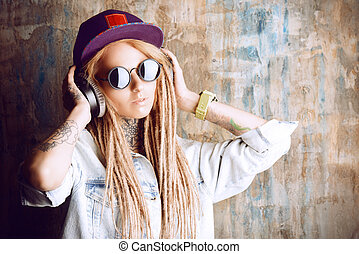 pop style - Trendy teenage girl with blonde dreadlocks...