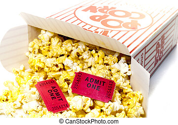 Closeup of box of popcorn on roll of movie tickets. Isolated on white background with clipping path.