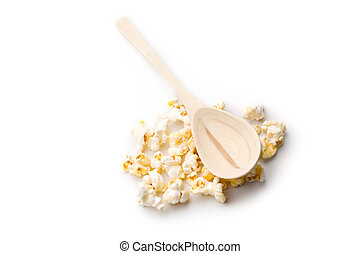 Popcorn and spoon isolated on white