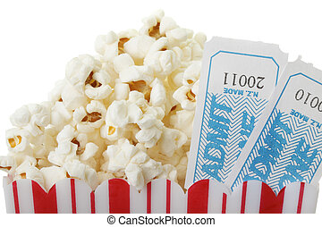 Popcorn and tickets. - A cup of popcorn and two movie...