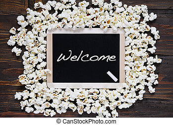 Popcorn and word welcome. - Popcorn and blackboard with the...