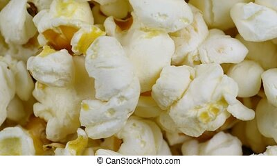 popcorn background rotates, close up, seamless loopable