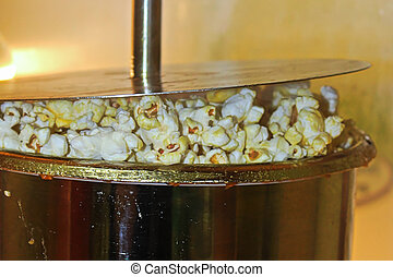 Popcorn being popped in a kettle.