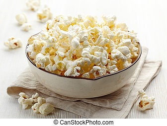 Popcorn - Bowl of fresh popcorn on white wooden background