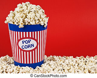 Popcorn bucket - A popcorn bucket over a red background.