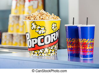 Popcorn Bucket With Drinks On Concession Counter - Popcorn...