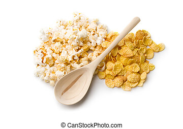Popcorn, cornflakes and spoon isolated on white