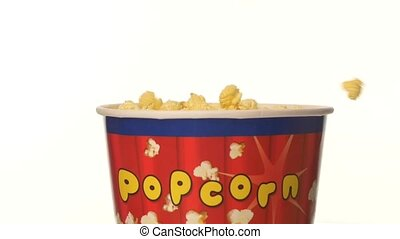 Popcorn falling in a bag, on white, 2 pack, slow motion