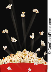 Popcorn flying high.