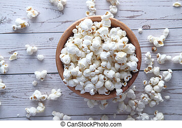 popcorn in a bowl on table, top view