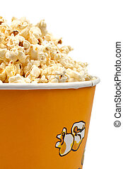 Popcorn in a bucket - Detail of popcorn in a bucket over a...