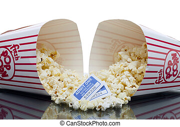 popcorn in a red bucket with movie tickets