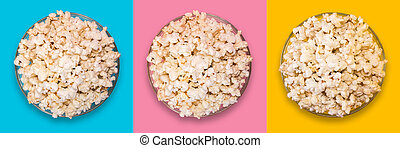 Popcorn in a transparent plate on a blue, yellow and pink background